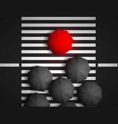 red umbrella and black umbrellas on a background vector image