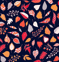 Seamless pattern with colored autumn leaves on a vector