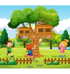 Three kids playing at the treehouse vector