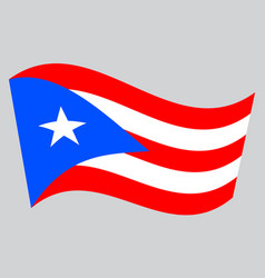 flag of puerto rico waving on gray background vector image