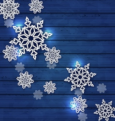 Christmas set snowflakes on wooden background vector