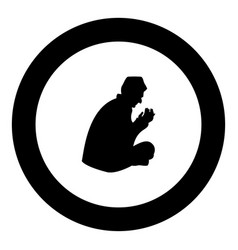 praying muslim icon black color in round circle vector image