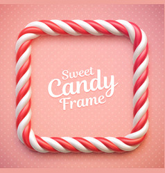 Candy cane frame on polka dot background vector