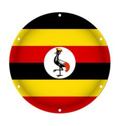 Round metallic flag of uganda with screw holes vector