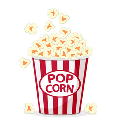 Popcorn flies in a full bucket on a white vector