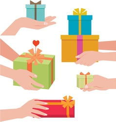 Hand giving a gift box vector