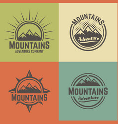 mountains four colored vintage emblems vector image