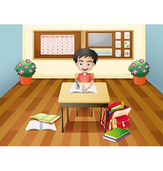 A boy writing at the table vector