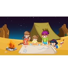 Children camping out in the desert vector image