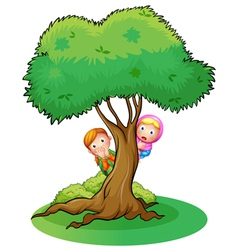 Two girls hiding at the tree vector