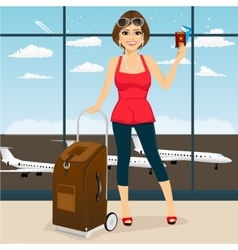 Woman holding her passport and tickets vector