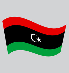flag of libya waving on gray background vector image