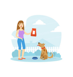 smiling woman owner feeding her dog in backyard vector image