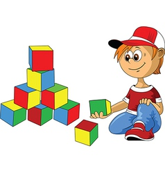 Boy with building blocks vector image vector image