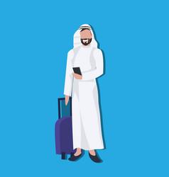Arabic businessman using smartphone holding valise vector