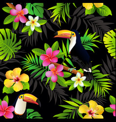 Tropical birds toucans and palm leaves seamless vector