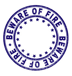 Scratched textured beware of fire round stamp seal vector