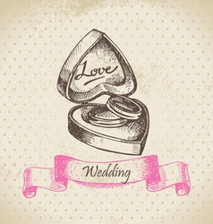Box with wedding rings hand drawn vector image