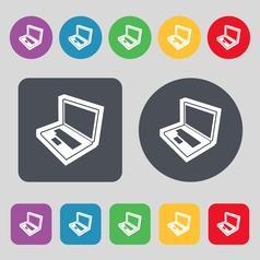 Laptop icon sign A set of 12 colored buttons Flat vector image