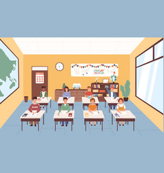 smiling pupils sitting at desks in classroom vector image
