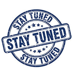 Stay tuned blue grunge round vintage rubber stamp vector