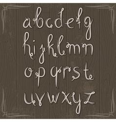 alphabet on wooden background vector image