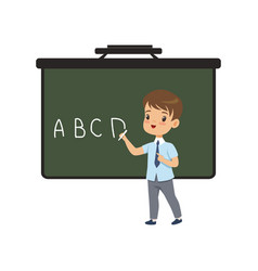 Boy writing english letters on blackboard vector