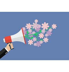 Hand holding megaphone with flowers vector