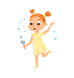 Lovely redhead girl blowing soap bubbles through vector