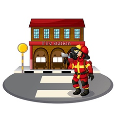 A fireman in front of the fire station vector image