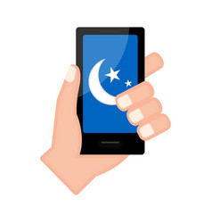 Hand holding a smartphone with a moon shape icon vector