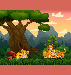 Tiger cub and lion playing under t vector