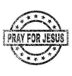 grunge textured pray for jesus stamp seal vector image