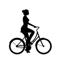 Woman riding bike vector