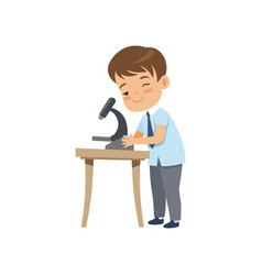 cute boy using microscope at lesson pupil in vector image