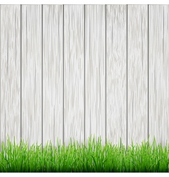 Green grass on white wood boards background vector
