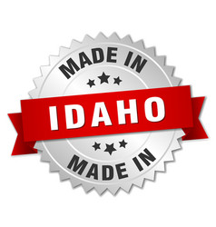 Made in idaho silver badge with red ribbon vector