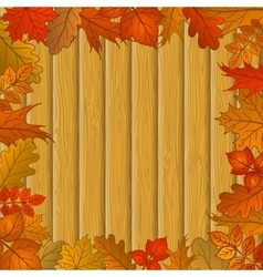 Autumn leaves and wooden fence vector image