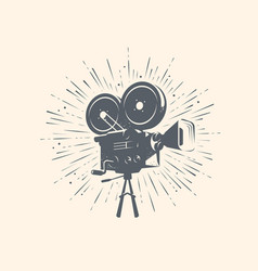 Cinema video logo or label retro movie camera vector