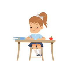 Cute girl sitting at the desk and writing vector