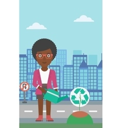 Woman watering tree with recycle sign instead of vector