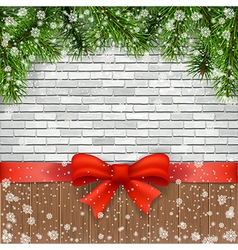 Pine branches and bow on a background of bricks vector image