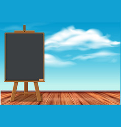 black chalkboard with blue sky in background vector image