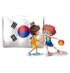 Two boys playing basketball in front of the Korean vector image