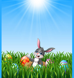 happy easter rabbit out of holes in the ground wit vector image