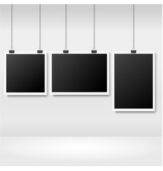 realistic photo frames hanging on binder vector image