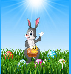 easter bunny holding a basket with easter egg and vector image