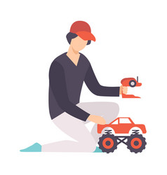 Young man playing with radio controlled car guy vector