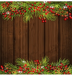 Fir branch and red berries on a wooden background vector