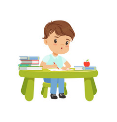 Cute little boy character sitting at the table and vector